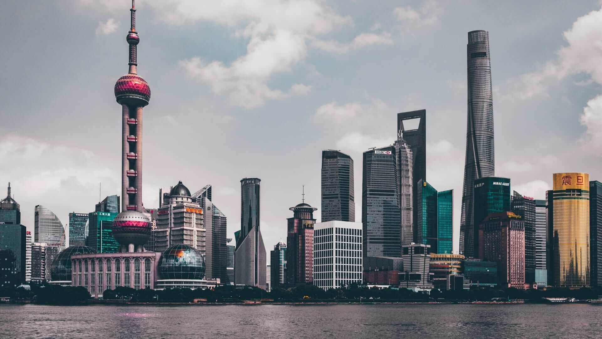 Buildings next to the water during daytime in Shanghai.