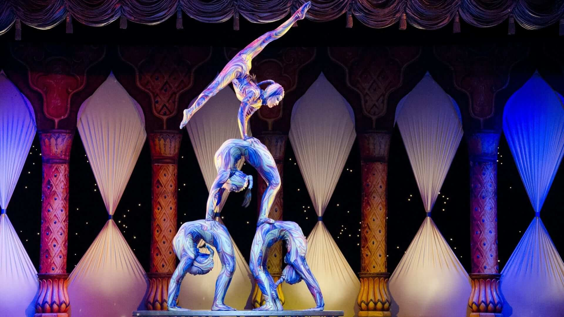 Acrobats are making a human paramide in a circus or theatre in Shanghai.