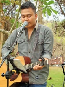 musician from bali entertaining the students