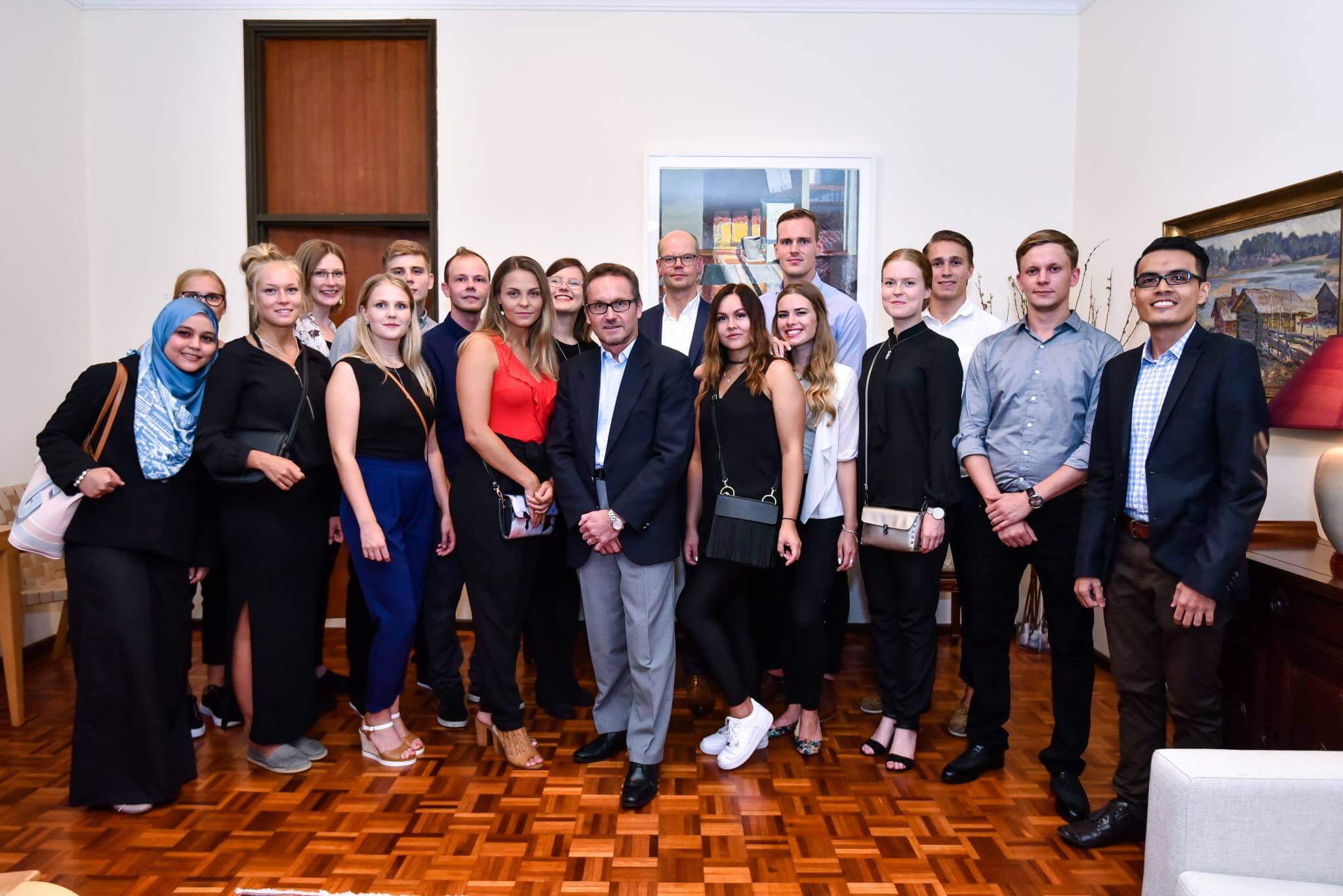 A group picture of Finnish students at an ambassy building in Malaysia.