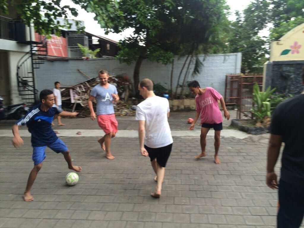 playing footballs (soccer) with teenager