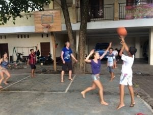 entertaining the children by playing basketball