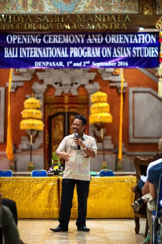 guy is welcoming the students in university in bali