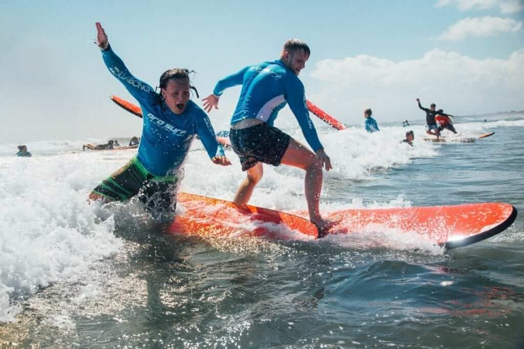 students learn to surf in bali