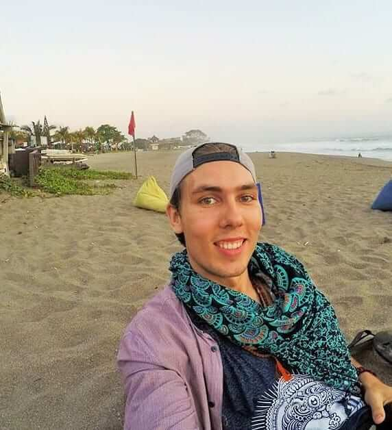 man took a selfie on the beach somewhere in bali indonesia