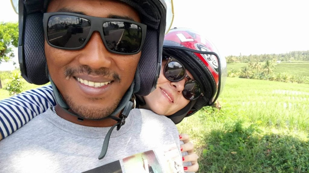 couple is smiling in front of camera