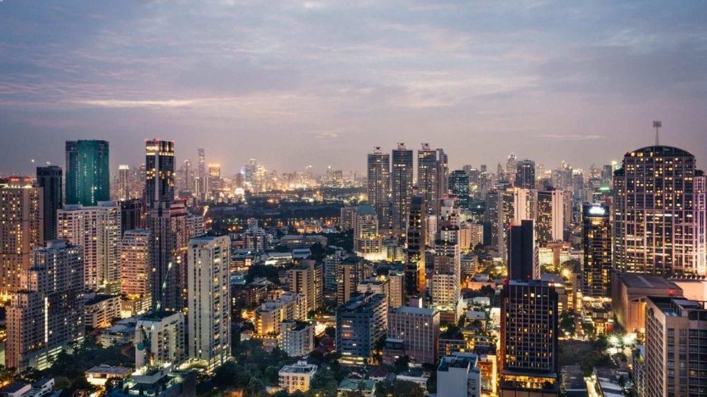An aerial view of high illuminited buildings in Bangkok.