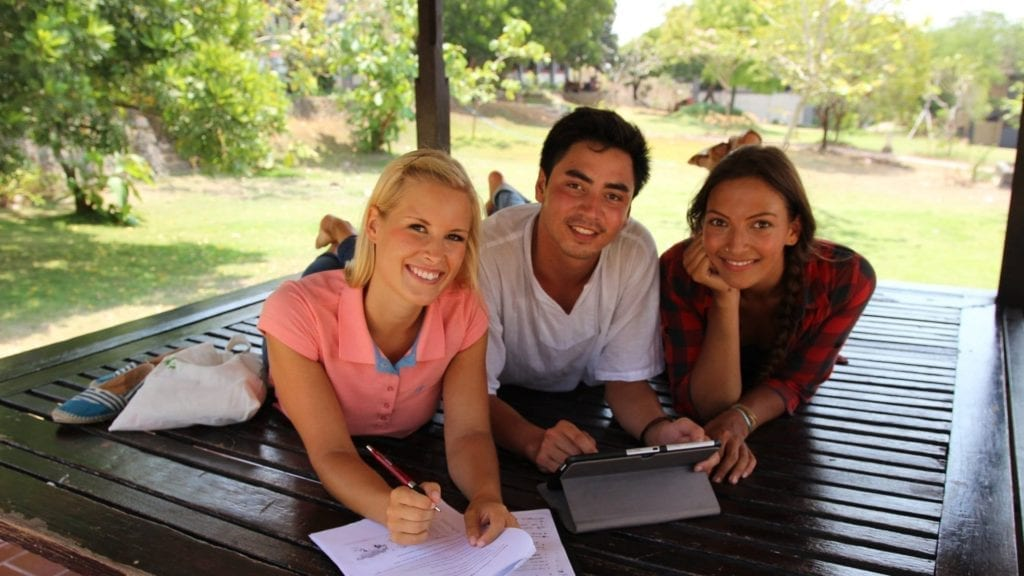 exchange student in bali studying in the gazebo