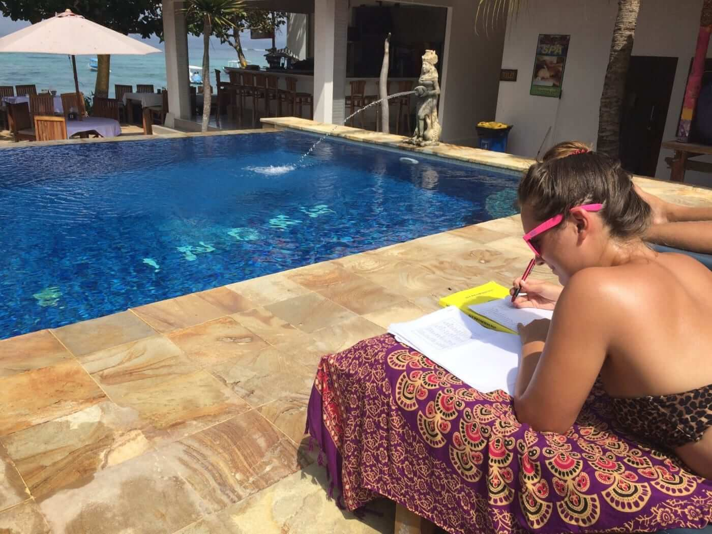 studying in front of the pool
