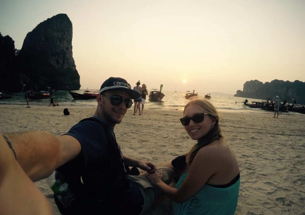 a couple is enjoying their time on the beach in phuket