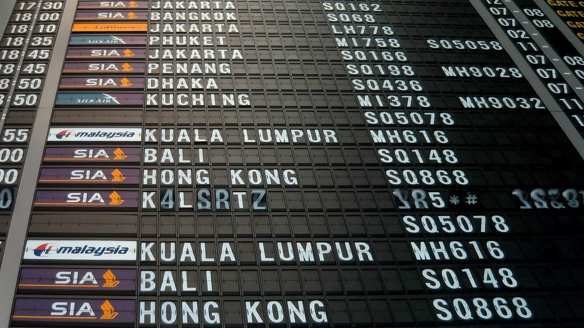 List of flights on a display board at an airport