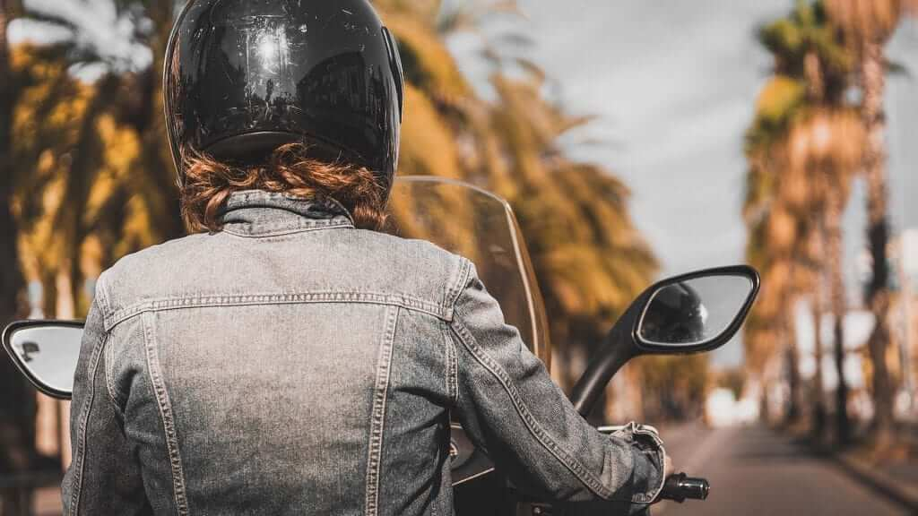 A girl riding a motorbike in Bali