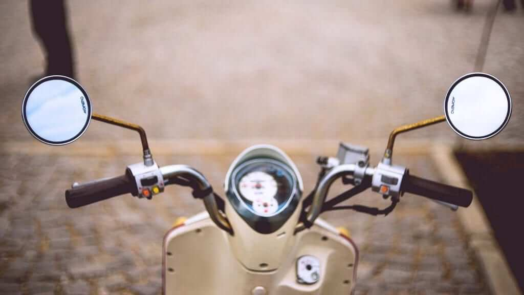 The front of a white scooter