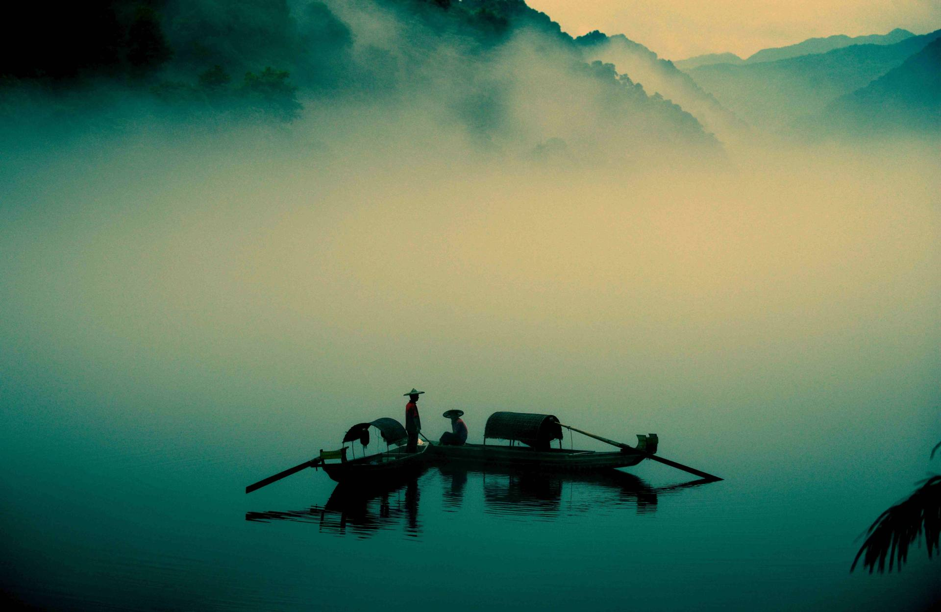 Two boats are laying in a lake in foggy weather in China.