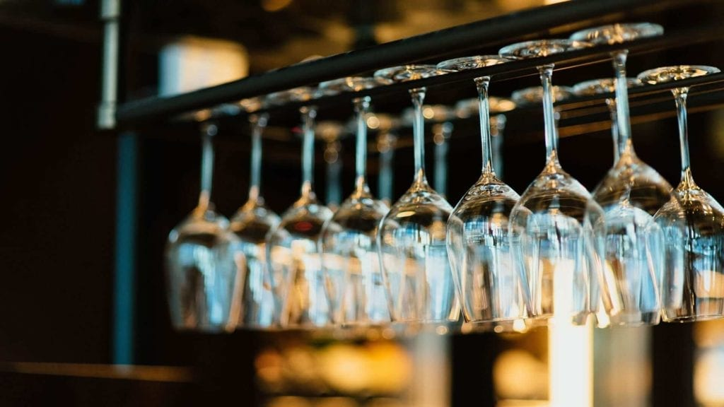 Wine glasses hanging in bar