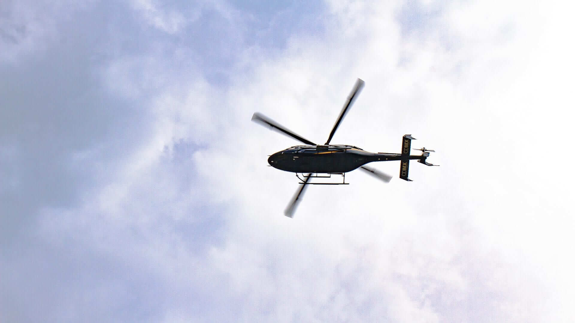 A flying helicopter seen from below