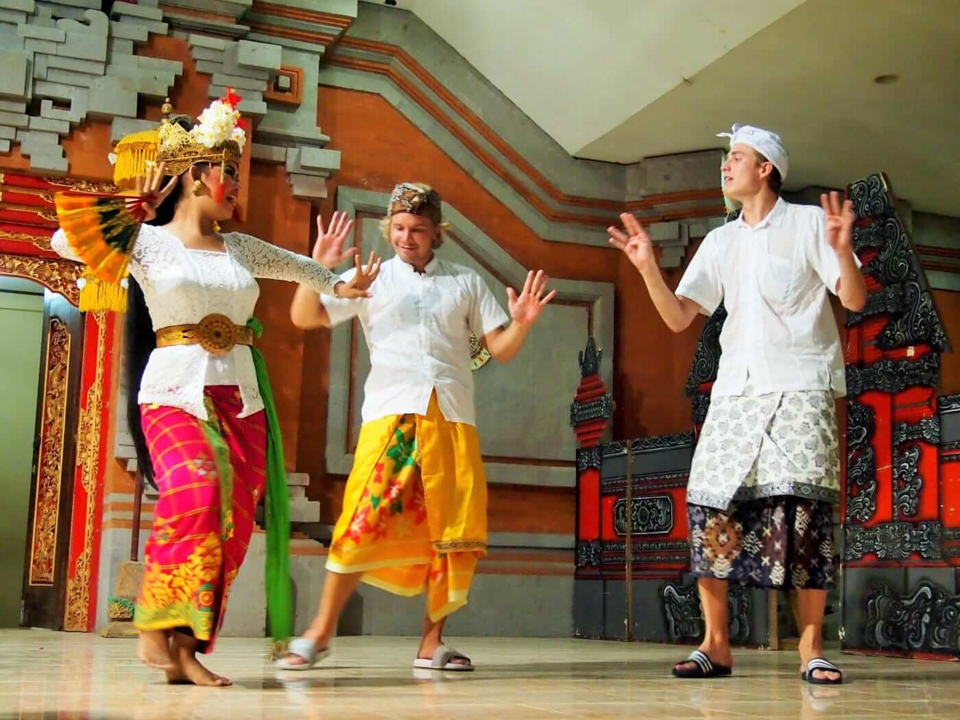 students dancing traditional balinese dance along with balinese girl