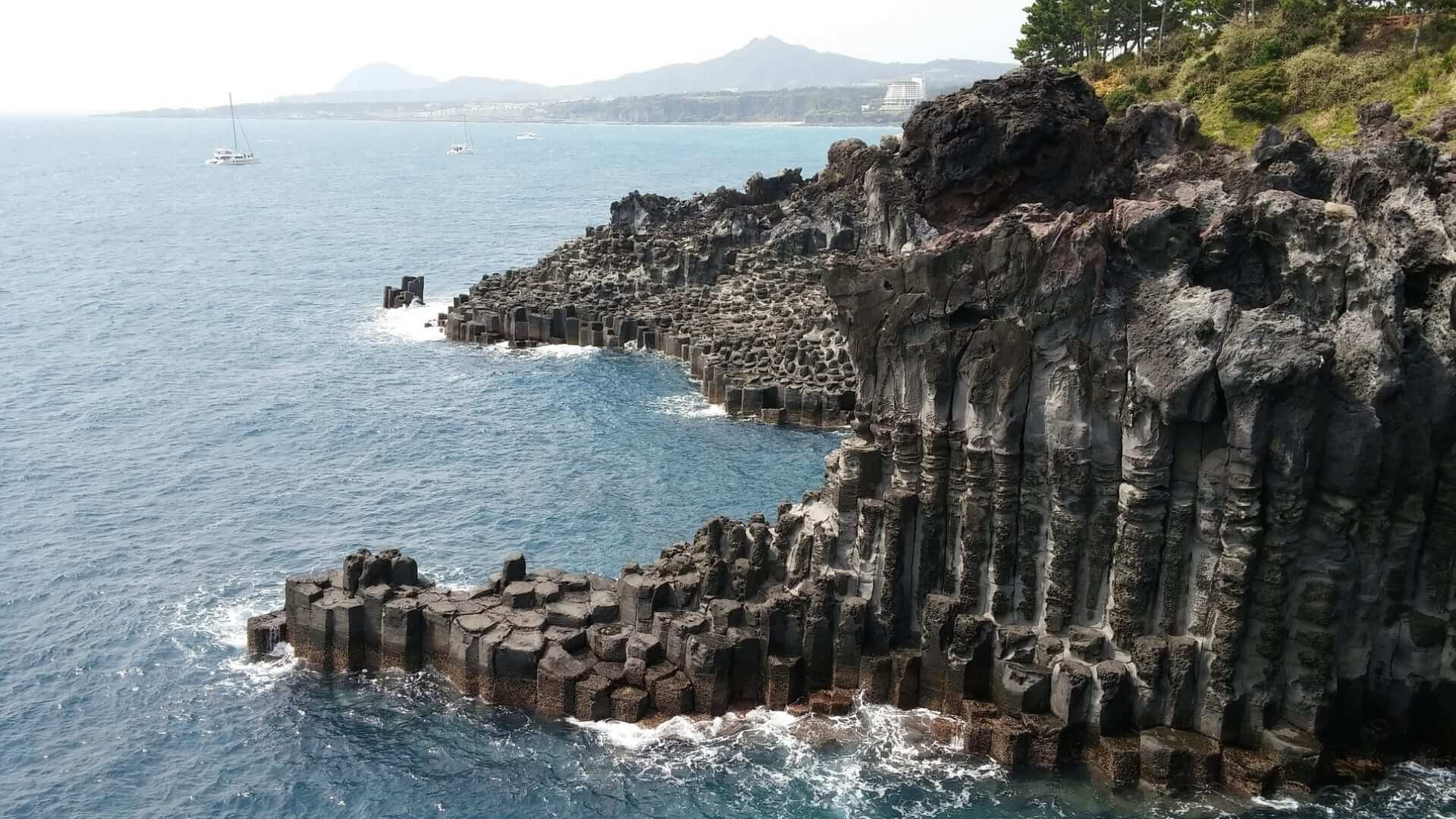 A cliff on the Jeju Island consisting of black rocks in Korea.