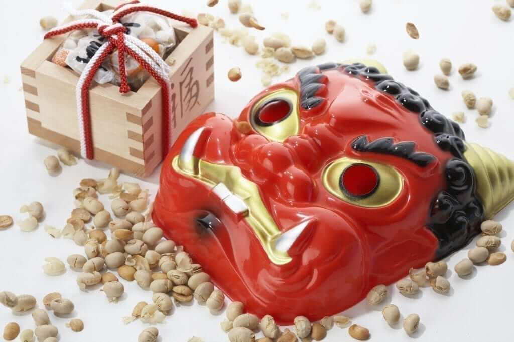 a red mask with beans scattered around