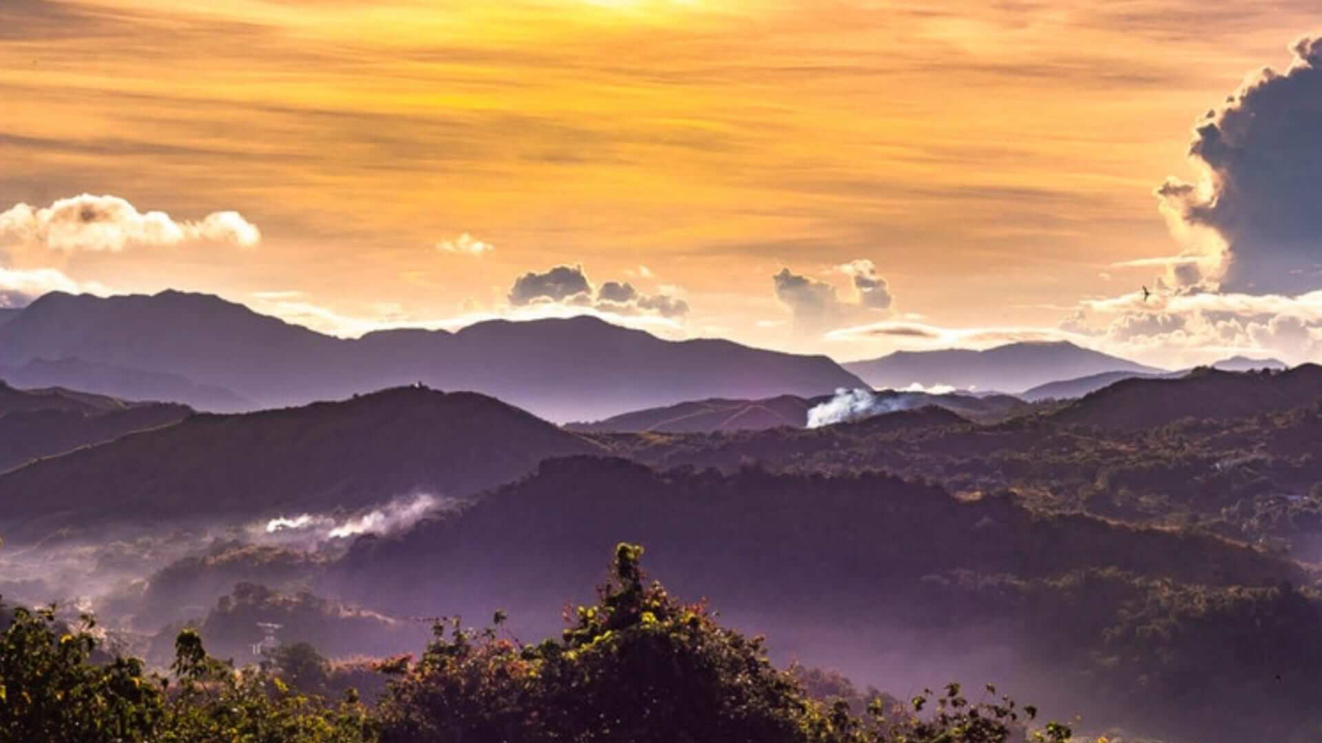 A sunrise above mountains in The Philipines.