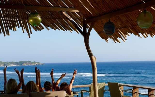 people enjoy their freetime near the ocean in bali