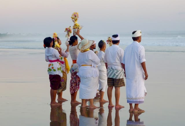 Balinese bringing their offerings to the sea
