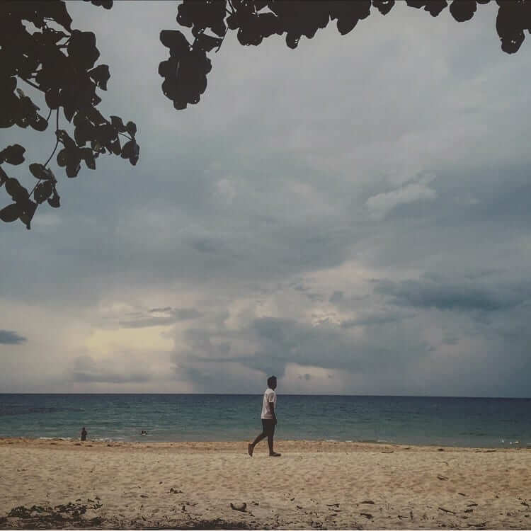 a man walking on the shore