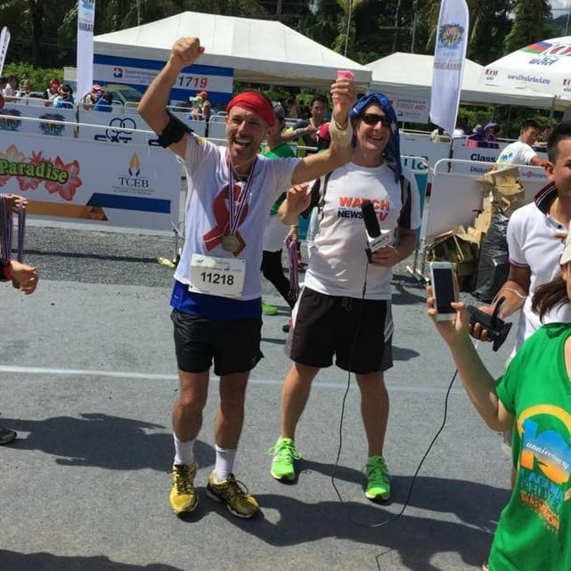 guy cheering after runs for 42 kilometers
