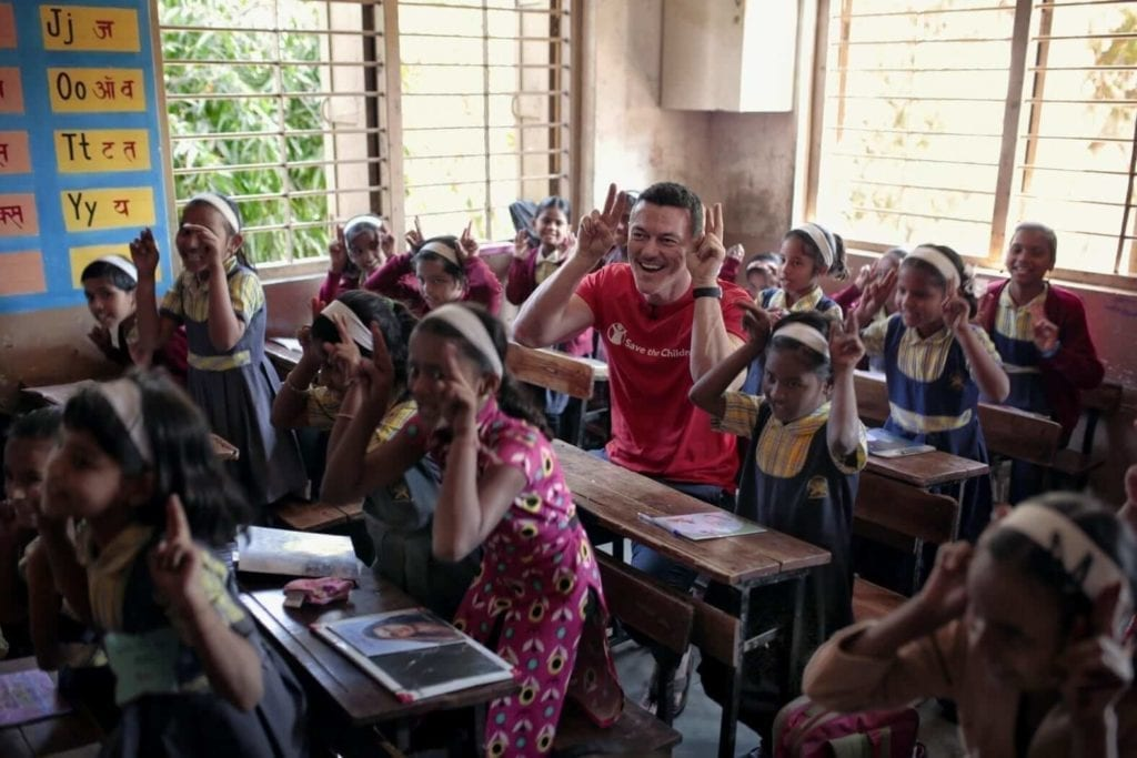 Children are making funny faces in a classroom