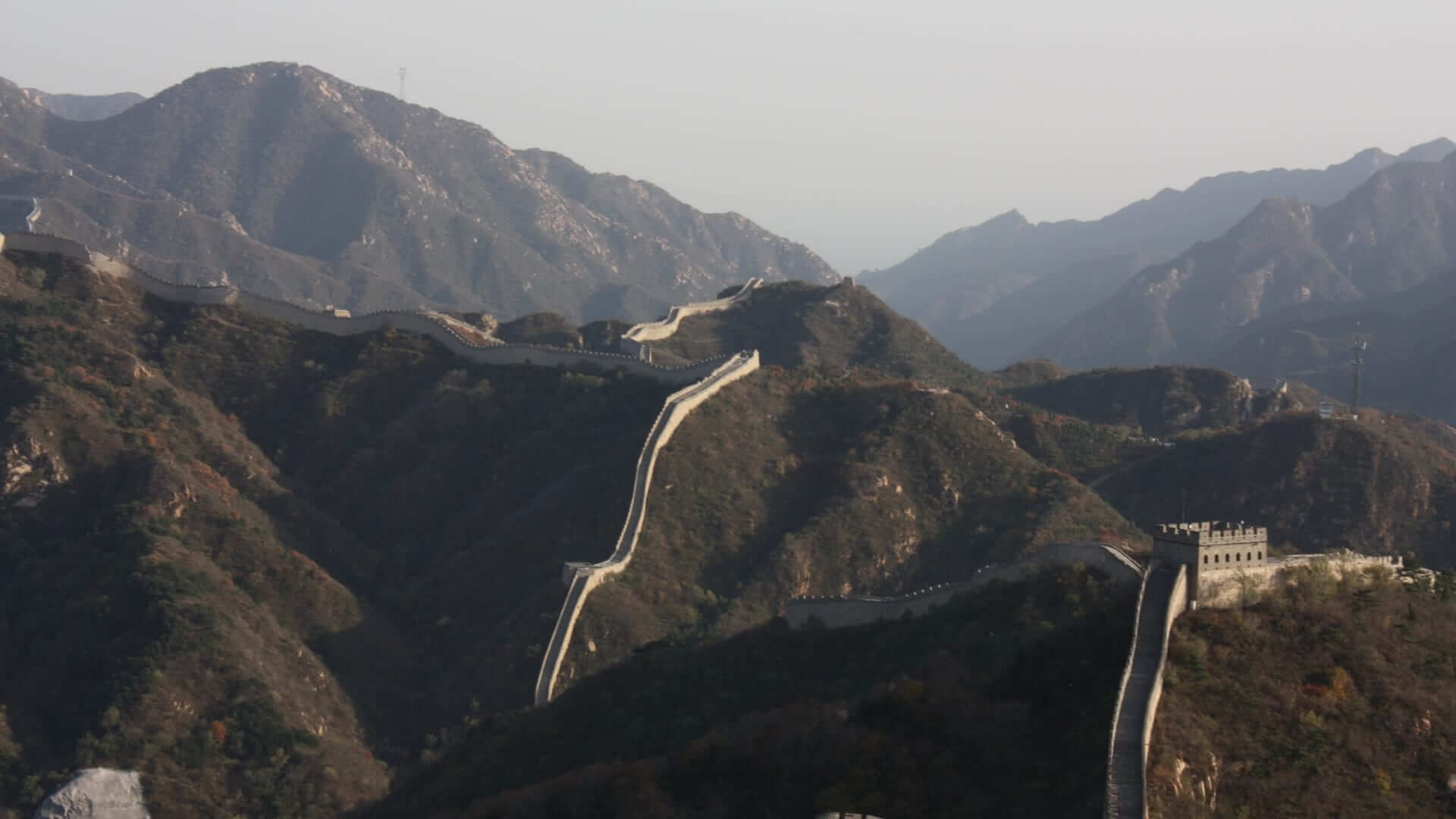 A great big wall across mountains in China.