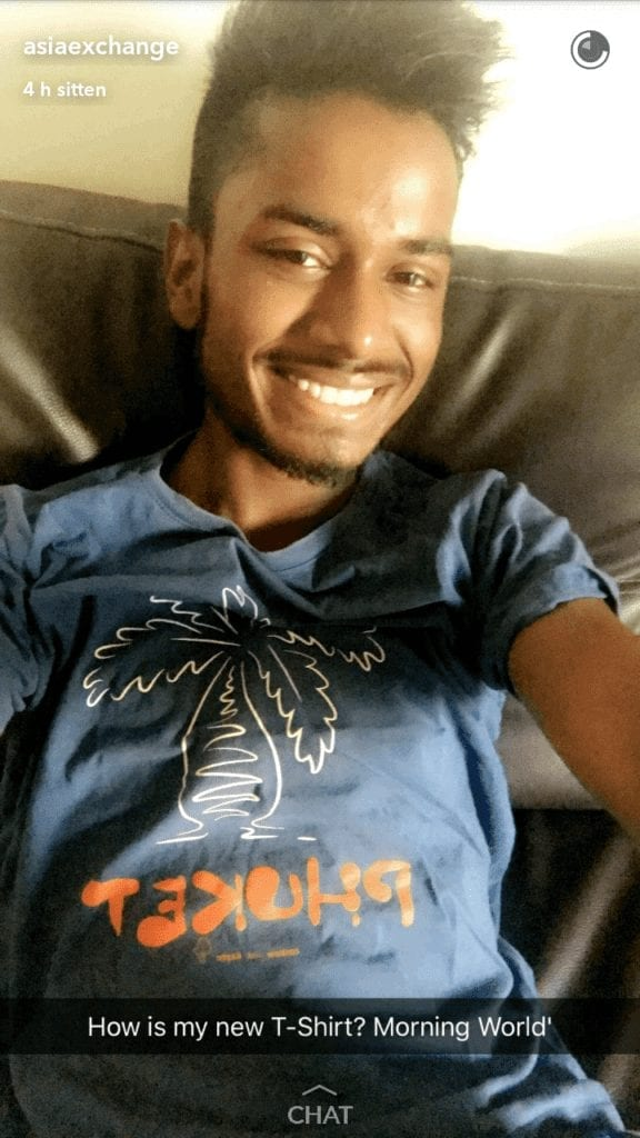 a snapchat of a smiling guy in blue shirt screenshot