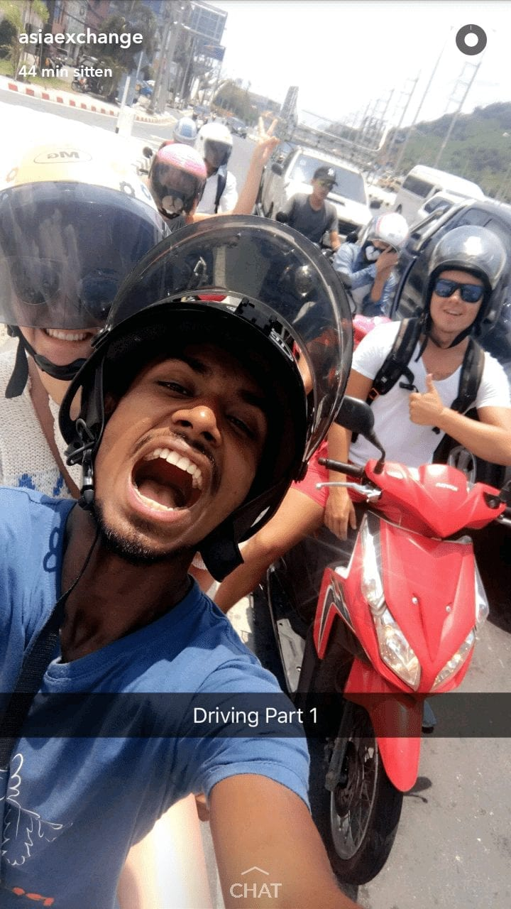 a snapchat of a guy wearing a helmet with a girl back ride screenshot