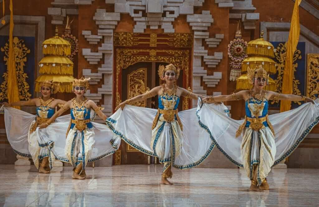 3 balinese woman performing balinese traditional dance during opening ceremony of udayana university