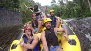 5 men enjoying the river rafting adventure