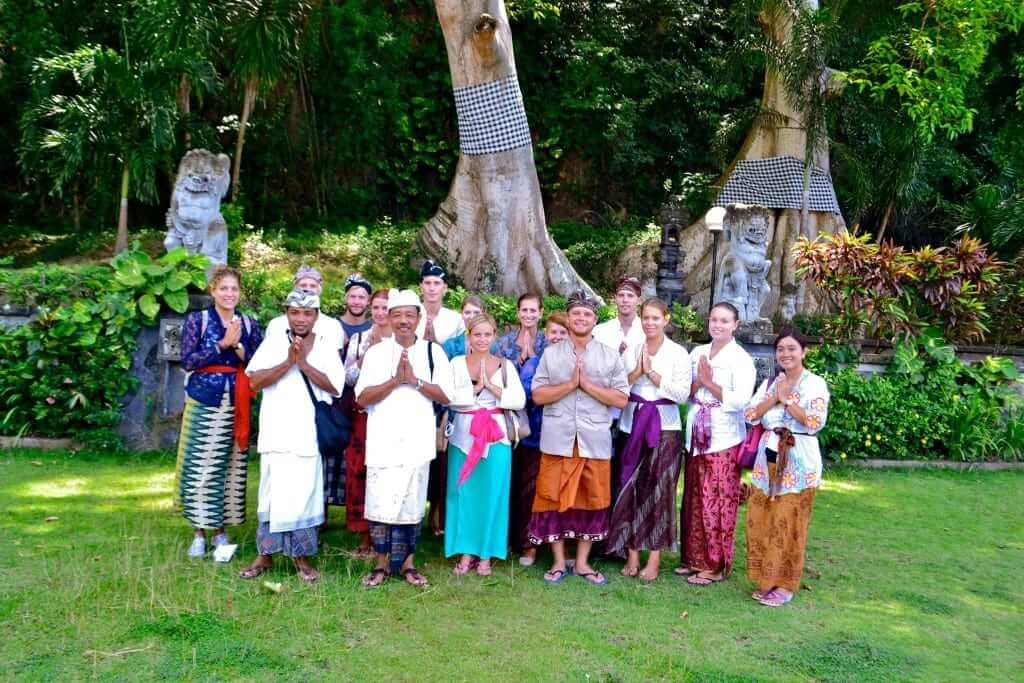 students and locals balinese sticking their palms to show respect and happiness