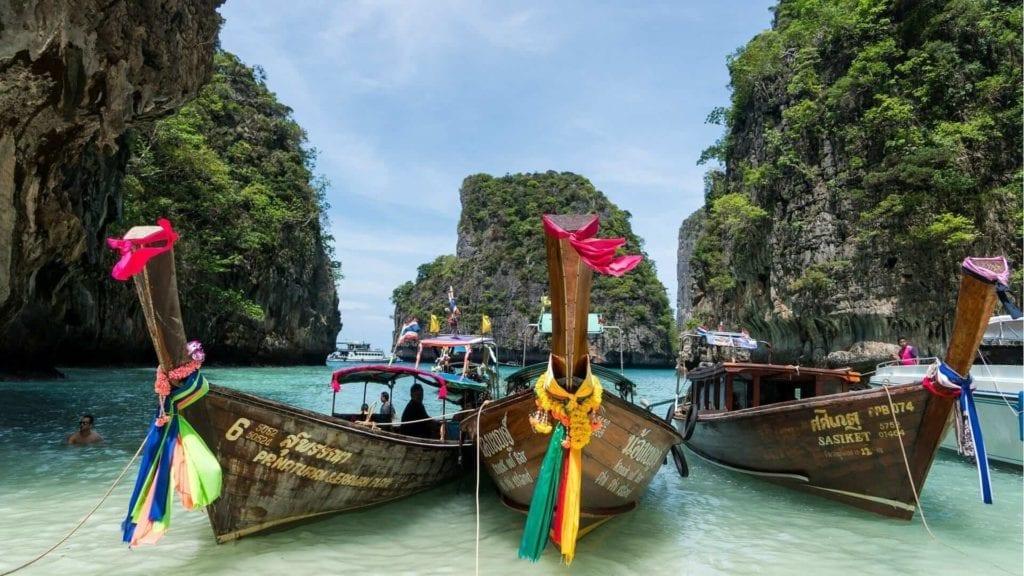longboats docked to the beach in phuket