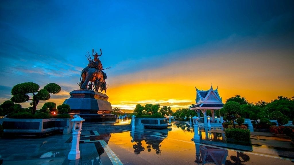 Traditional Thai architecture and statue during sunset