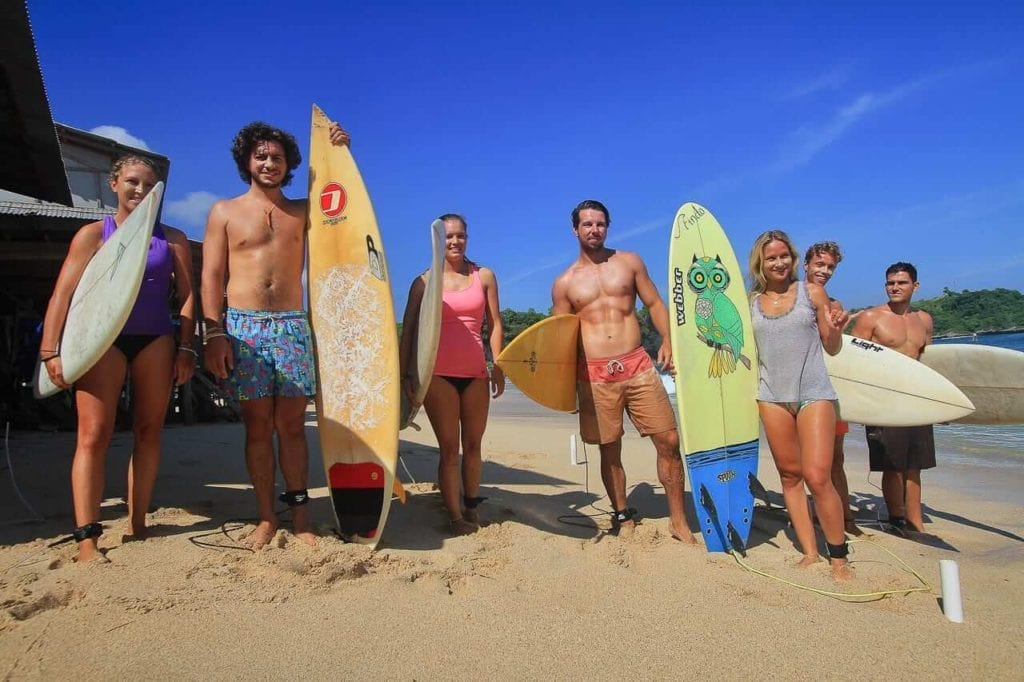 a group of surfers ready to surf in balangan beach
