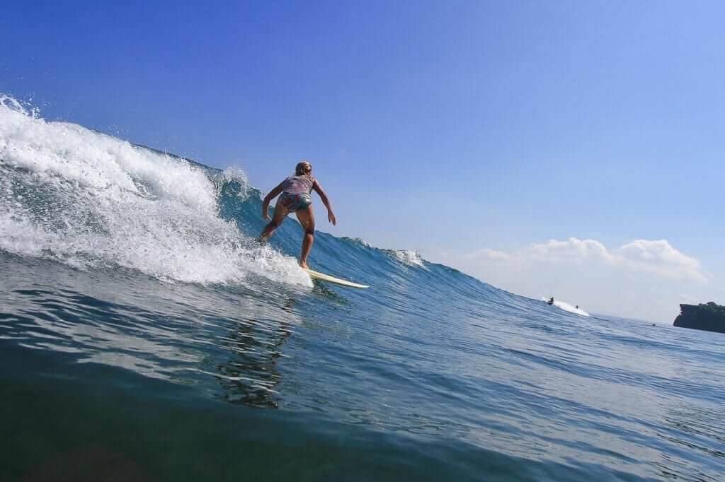 one of asia exchange student find a good waves for her surfi training session