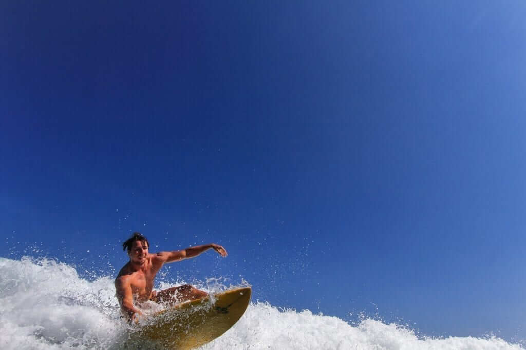a guy surfing with a rather unconventional approach to surfing.