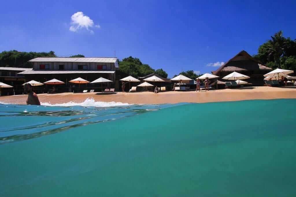 green water, beach, umbrella, blue sky