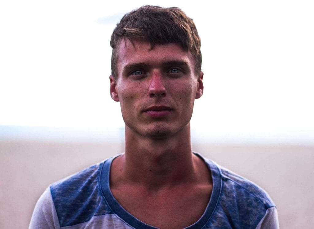 Tanned guy with blue and white shirt