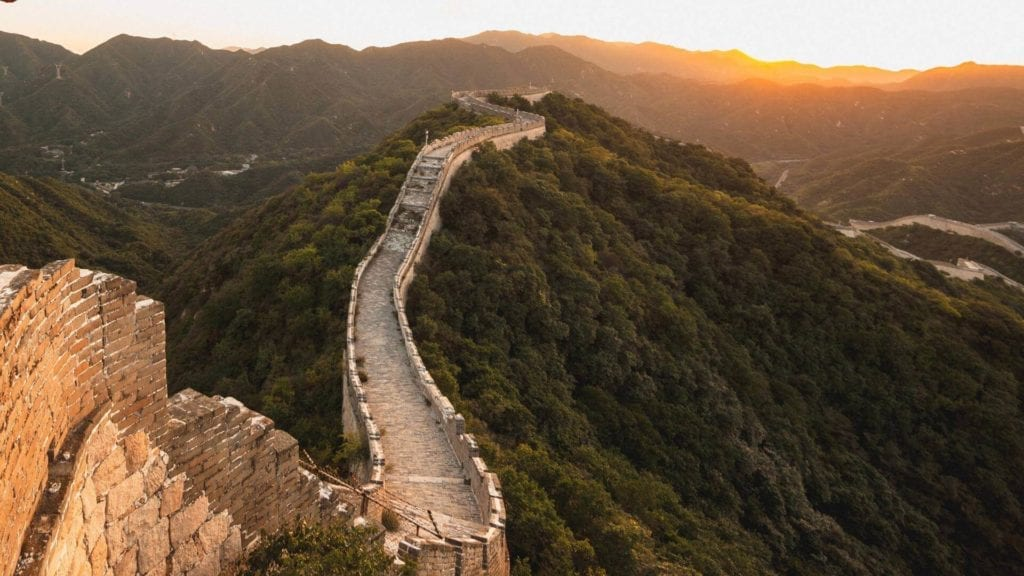 A panorama view of the magnificent Great Wall during sunset.