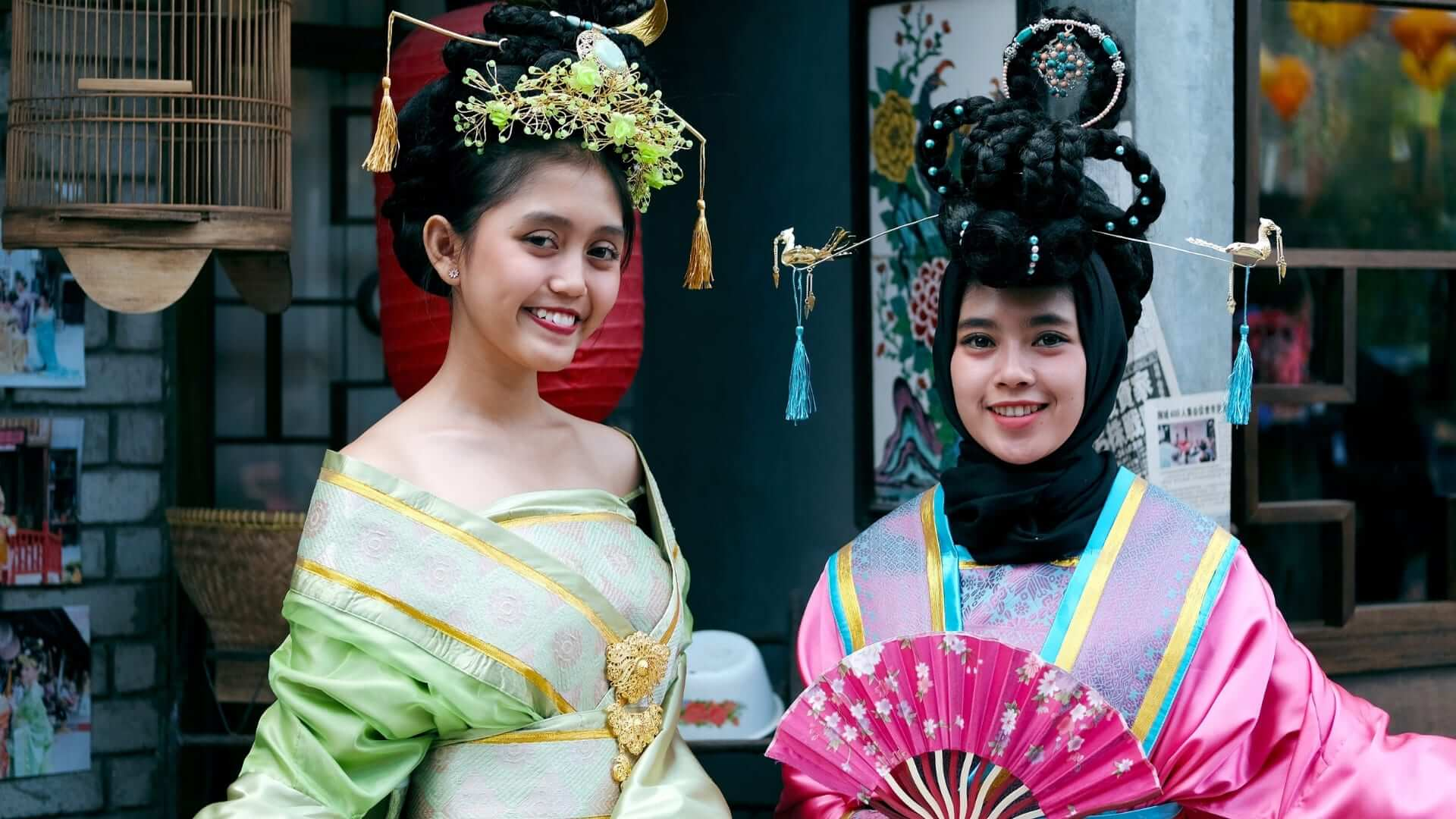 Two Chinese women in traditional Chinese clothes are smiling in China.