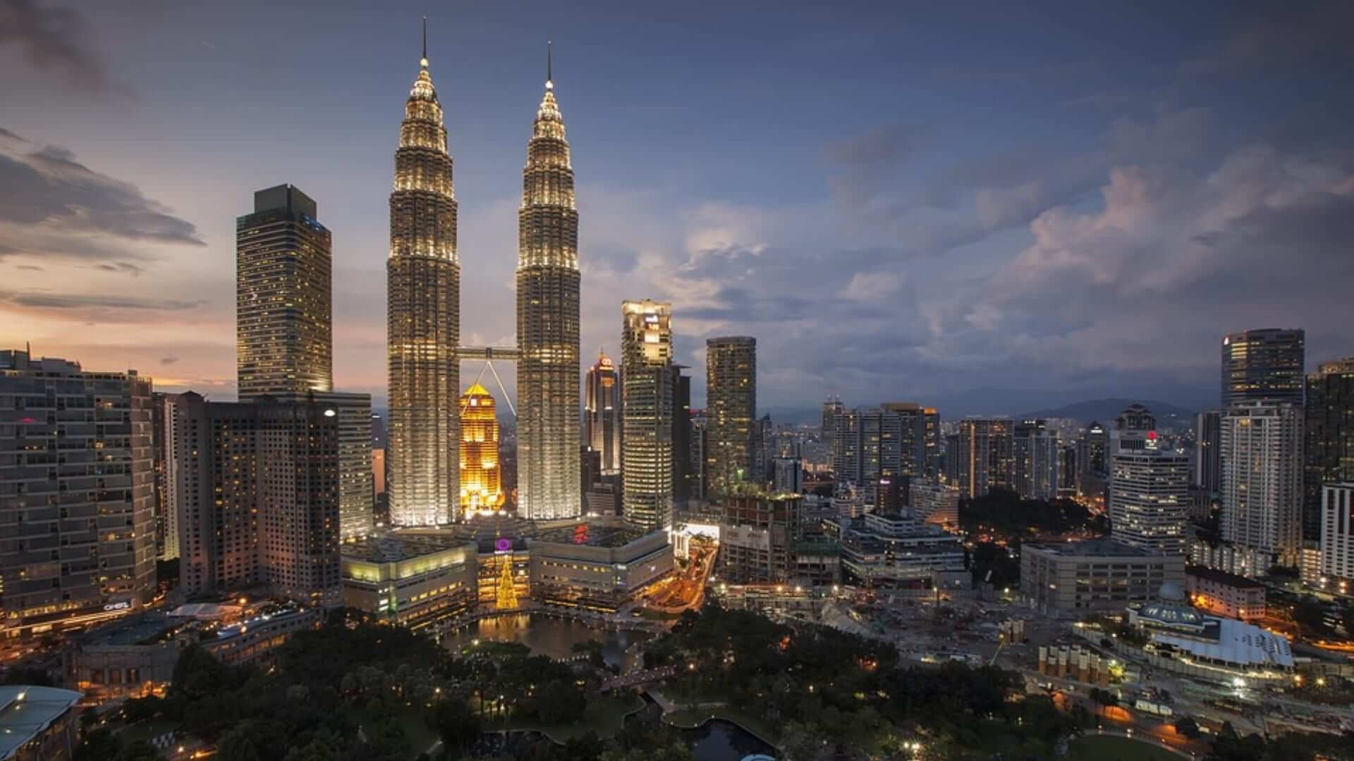 High buildings are illuminated during the evening in Kuala Lumpur.