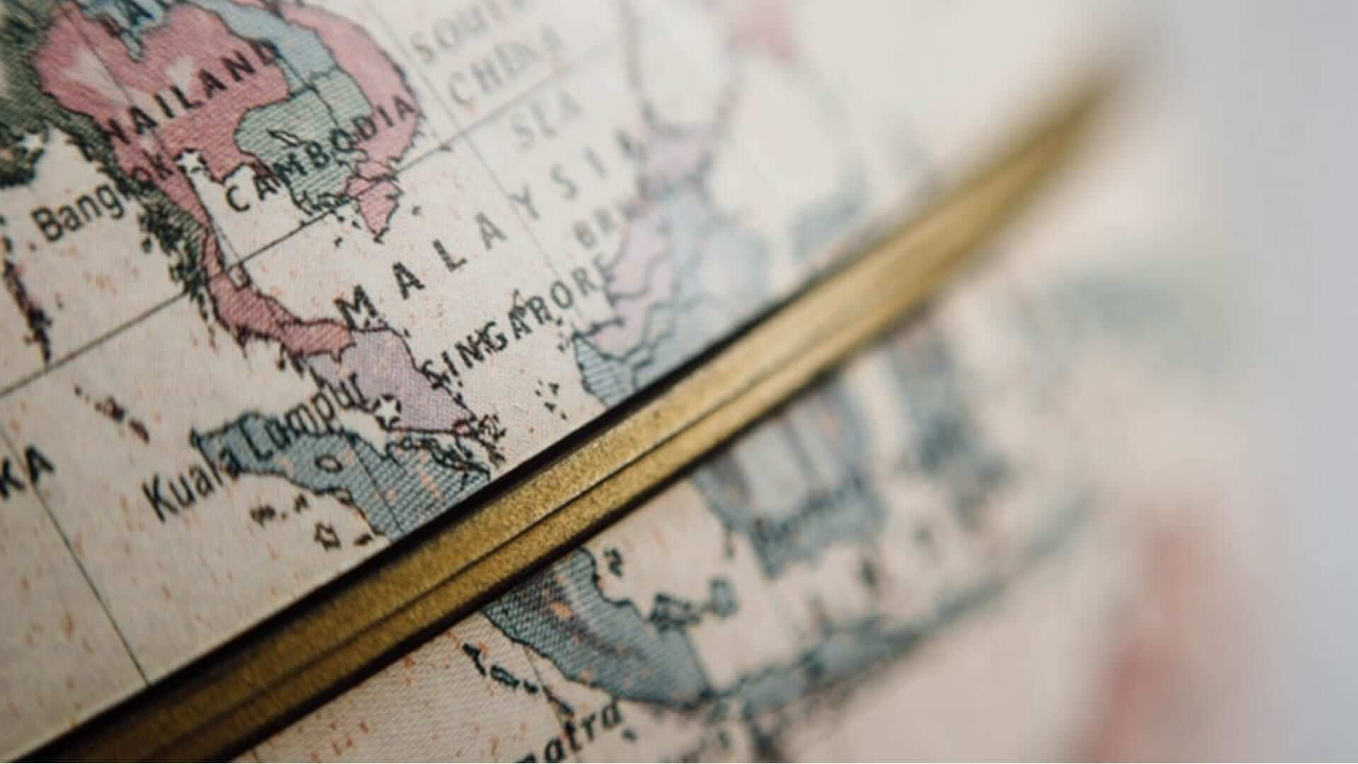 A piece of a globe with Malaysia, Singapore, Thailand and Kuala Lumpur on it.