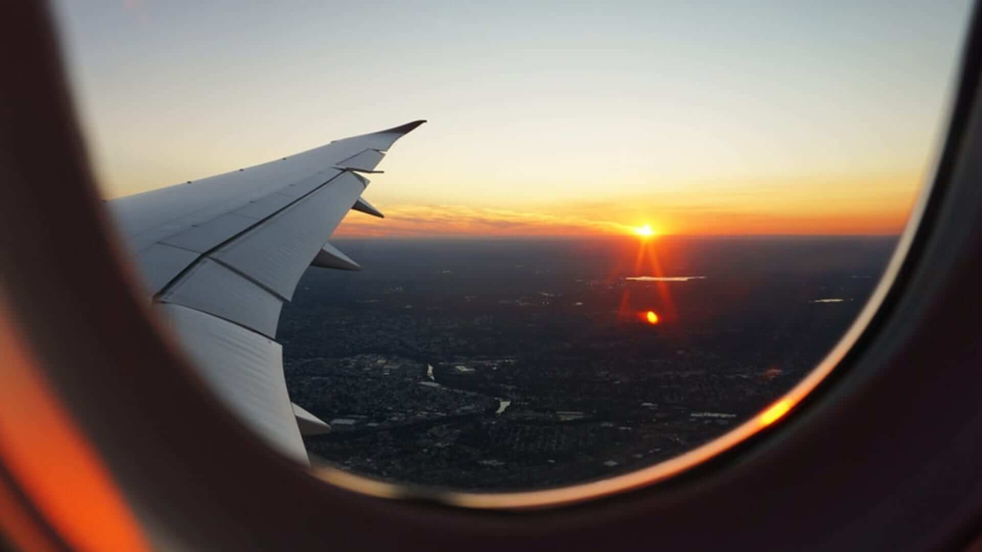 A view from an airplane window during sunset.