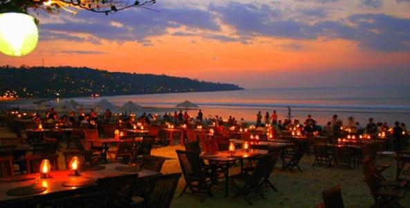 restaurant on the beach in jimbaran, bali, indonesia