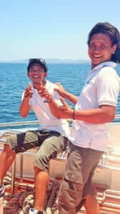 two guys smiling on the boat during the trip