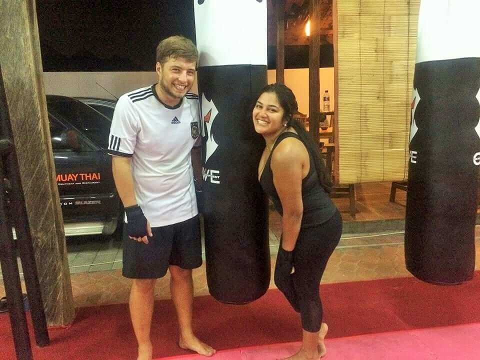 a girl and a guy doing muay thai martial arts training